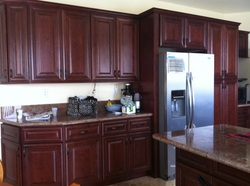 Mahogany Maple cabinets with Rose Lady counter top